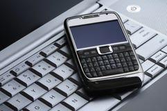 Mobiele telefoon, gsmand laptop Stock Afbeelding