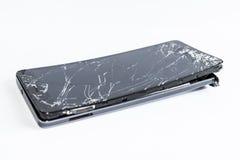 Mobiele telefoon met het gebroken scherm Stock Afbeelding