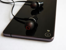 Mobiele telefoonhoofdtelefoon met mooi ontwerp Stock Afbeelding