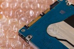 Mobil HDD på bubblasjalen, förpacka för hårddisk - bild arkivbild