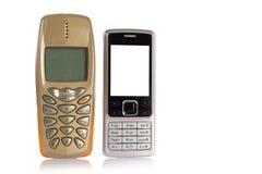 mobil ny gammal telefonförbättring Arkivbild