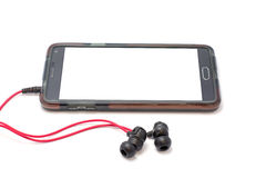 Mobil och headphone Arkivbild