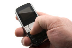 Mobil phone. In the hand on white background Stock Images