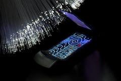 Mobil phone. Optical fiber floodlight Royalty Free Stock Image