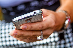 Mobil phone in the hand stock images