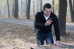 Mobil phone and man with smile Stock Photo