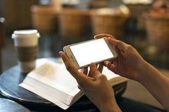 Mobil téléphonent dans la main photographie stock