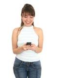 mobil telefon genom att använda kvinnabarn Royaltyfria Bilder