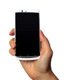 Mobil telefon i hand arkivbild