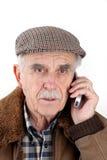 mobil telefonpensionär för man Arkivfoto