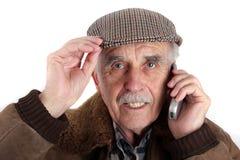 mobil telefonpensionär för man Arkivbild