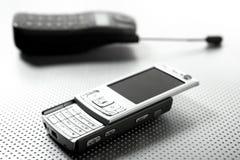 mobila nya gammala telefoner Arkivfoton