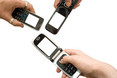 Mobile. Three mobile phones with empty screens on white Stock Photo