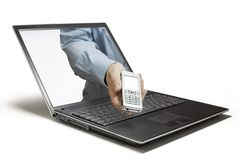 Mobile. Hands reaching out of a laptop Royalty Free Stock Image