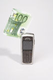 Mobile. Phone with a hundred euro bill on white background Royalty Free Stock Images