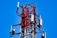 Mobile antenna with blue sky Stock Photos