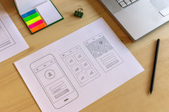 Mobile app prototype. On designer wooden desk Royalty Free Stock Photo