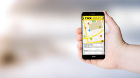 Mobile app taxi on user´s hand Royalty Free Stock Photography