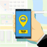 Mobile app to call a taxi. Man holding a smartphone in his hand. Royalty Free Stock Photography