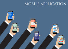 Mobile application concept. Hands holding phones. Royalty Free Stock Photography