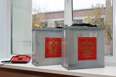 Mobile ballot box to vote in the elections outside. Two mobile ballot box to vote in the elections outside with coat of arms Russian Federation stock photo