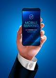 Mobile banking. Hand of a businessman in a business suit shows the screen of the smart phone or mobile phone. Transfer money through mobile banking on the mobile Stock Photos