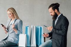 Mobile banking online shopping couple credit cards royalty free stock photos