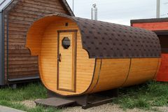 Mobile bath in the form of a wooden barrel. royalty free stock photos