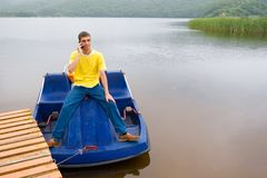 Mobile and boat. The young man and mobile Stock Photos