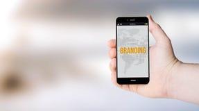 Mobile brandings on user´s hand Stock Photos