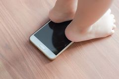 Mobile broken screen by kids. Kids tread phone on the floor royalty free stock images