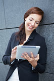 Mobile business woman with tablet Royalty Free Stock Photos