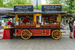 Mobile cafes in the form of old wagon. BERLIN - JUNE 14, 2015: Mobile cafes in the form of old wagon on the famous shopping street of West Berlin Royalty Free Stock Photography