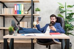Mobile call. Start day with coffee. Coffee relaxing break. Boss enjoying energy drink. Man bearded businessman hold cup royalty free stock images