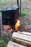 Mobile camp smokehouse warm on wood and fire. Mobile camp smokehouse warm on firewood and fire Royalty Free Stock Image