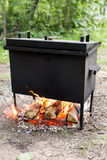 Mobile camp smokehouse warm on wood and fire. Mobile camp smokehouse warm on firewood and fire Stock Images