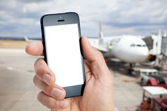 Mobile Cell Phone Airport. A cell phone with an airplane in the background at the airport stock photography