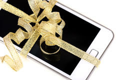 Mobile, cell-phone with gold ribbon Stock Photo