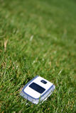 Mobile cell phone on grass outside. Mobile cell phone on green grass outside Stock Photo