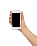 Mobile cell phone in hand with blank black screen for text copy Royalty Free Stock Images