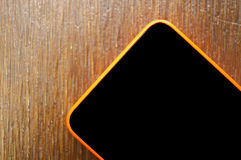 Mobile, cell phone on wooden table Royalty Free Stock Photography