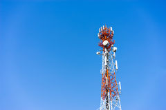 Mobile (cellular) tower antennas with blue sky background. Stock Photography