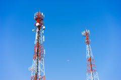 Mobile (cellular) tower antennas with blue sky background. Stock Photos