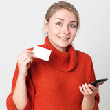 Mobile commerce for smiling girl making online transaction Stock Image