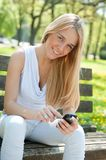 Mobile communication - smiling teenager Stock Photo
