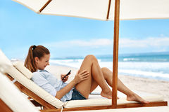 Mobile Communication. Woman Using Phone, Dialing Number On Beach Royalty Free Stock Images
