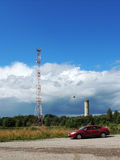 Mobile communications tower and old water tower in Povenets Royalty Free Stock Photography