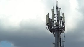 Mobile communications tower time lapse. Mobile communications tower against the sky. time lapse stock footage