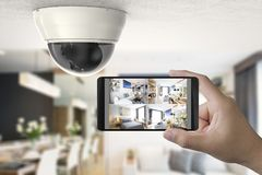 Mobile connect with security camera. Hand holding 3d rendering mobile connect with security camera stock image