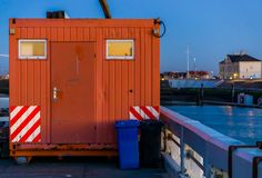 Mobile container office in the harbor near a construction site, transportable working place stock photo